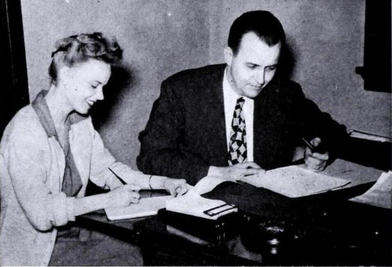 Alumni Secretary John Wagner and assistant