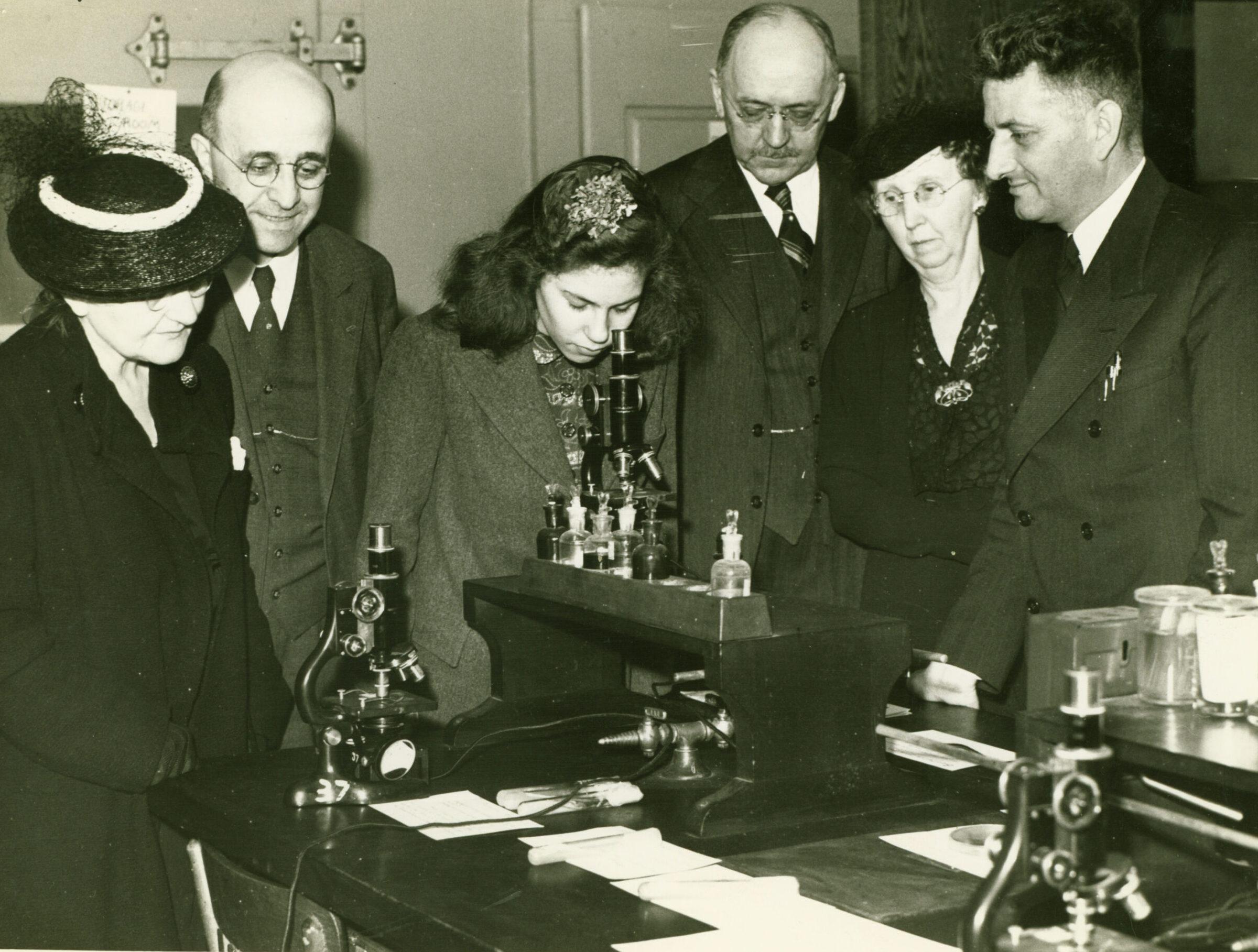 Dr. Shankweiler demonstrates lab equipment to visitors, circa 1935