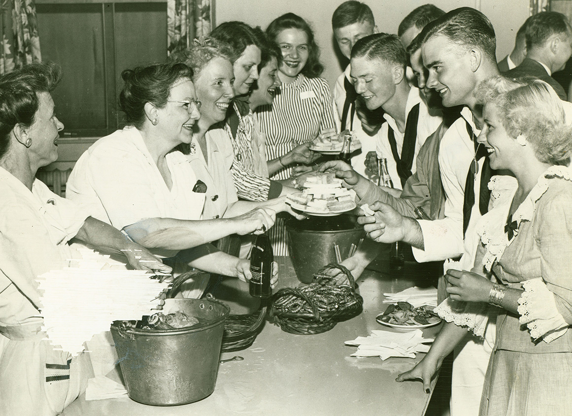 Members of the Women's Auxiliary and others serve students in the Navy v-12 Program, 1943