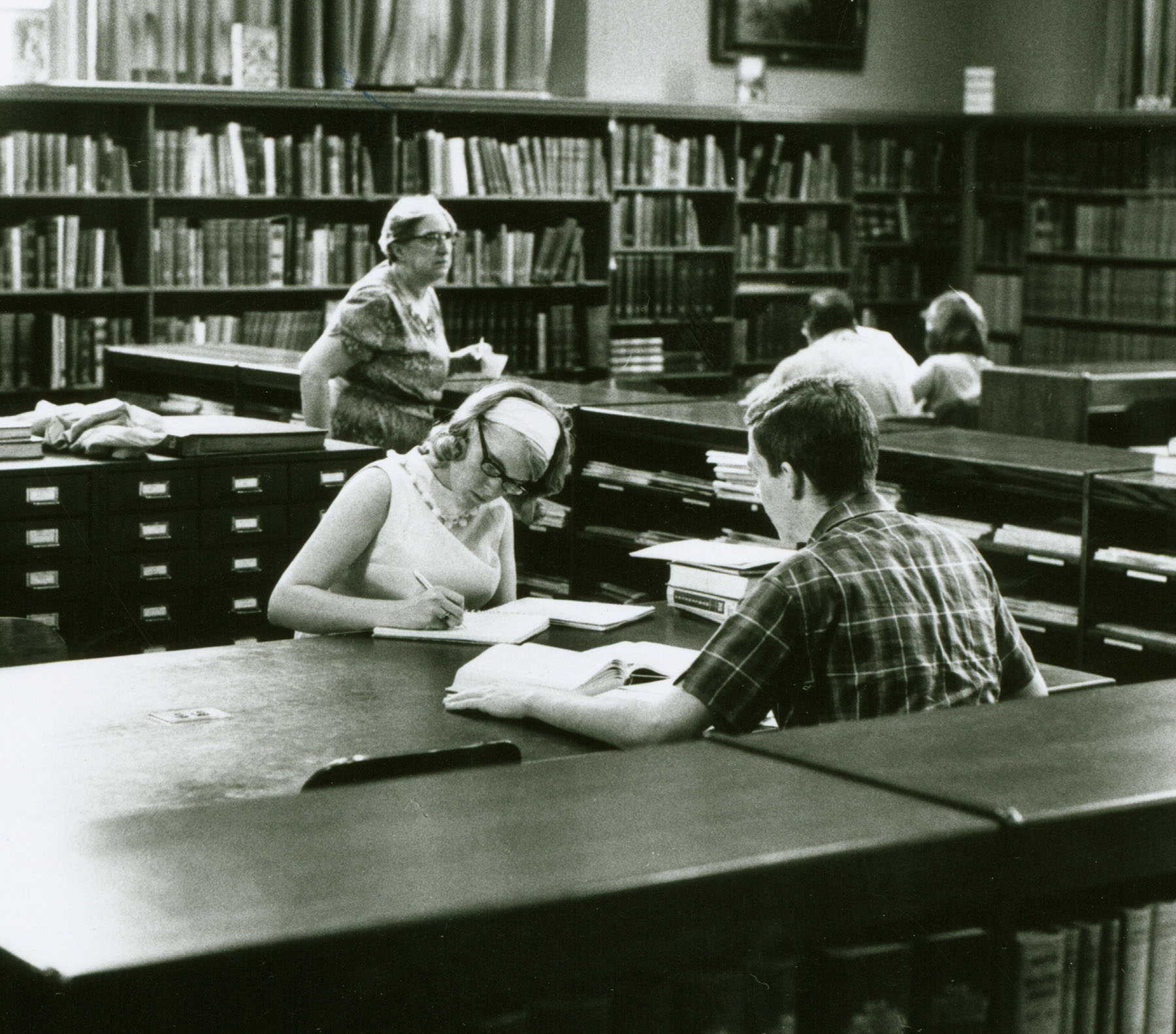 Librarian Mary Funk in Haas Library, circa 1965