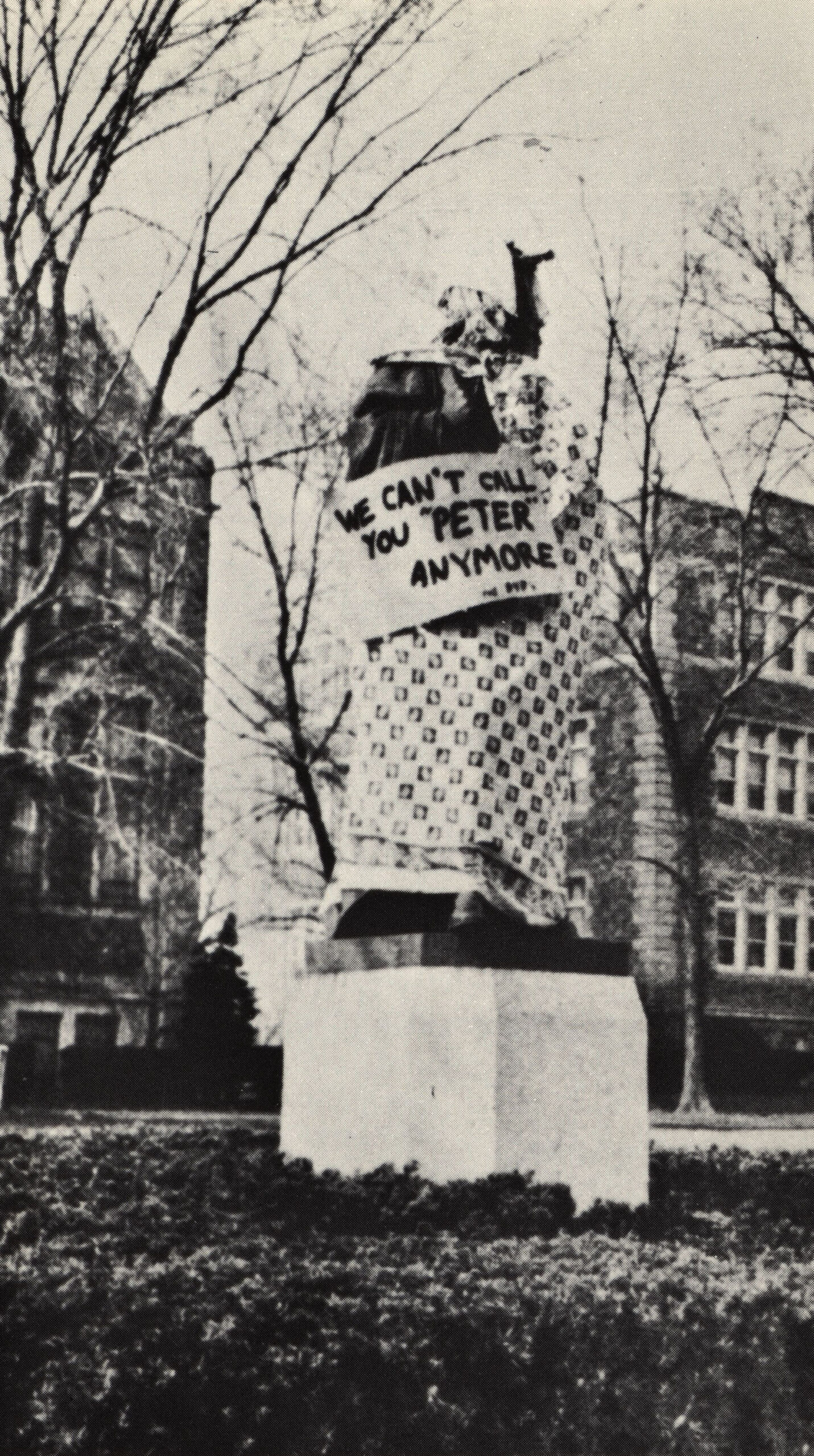 Statue of General Peter Muhlenberg is wrapped in a dress in protest of coeducation, 1957